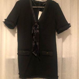 Black Zara dress with details.